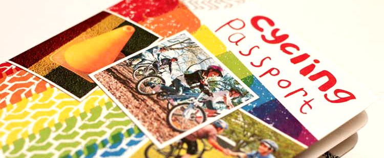 Bike NZ children's passport with rounded corner die cut.